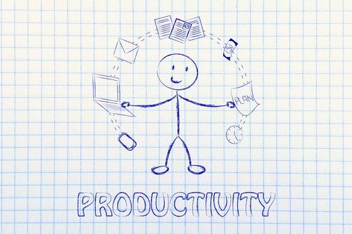 productivity and multitasking: business man juggling image